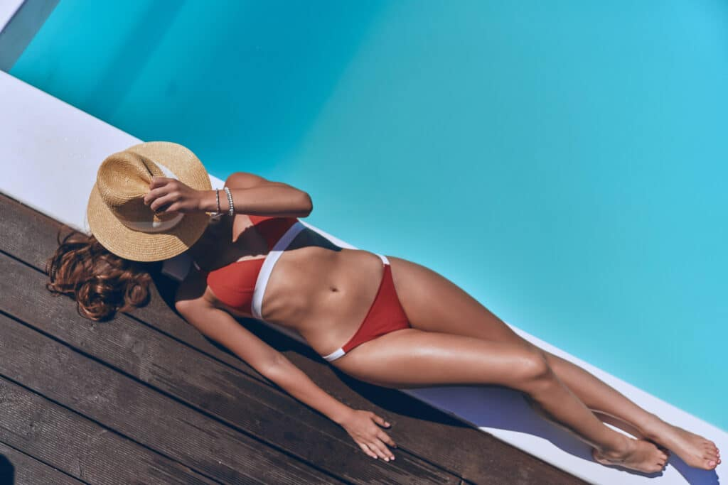 Sunbathing women - body sculpted with Exilis Therapy